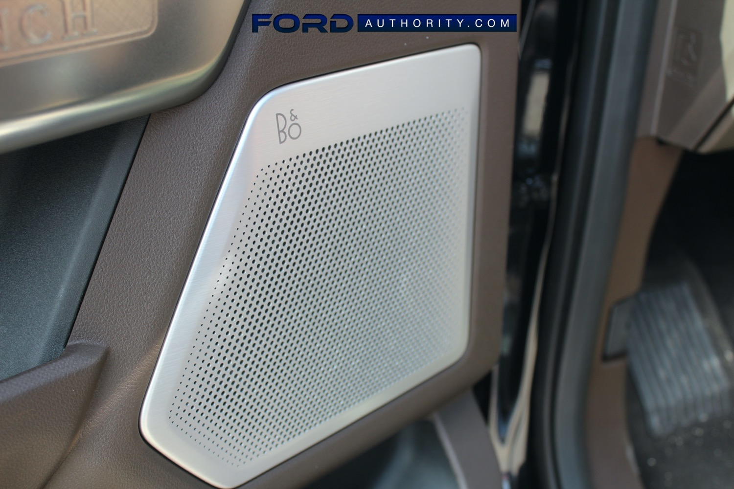 2021-Ford-F-150-King-Ranch-Interior-Front-Row-016-BO-speaker-grille-driver-side-door-panel.jpg