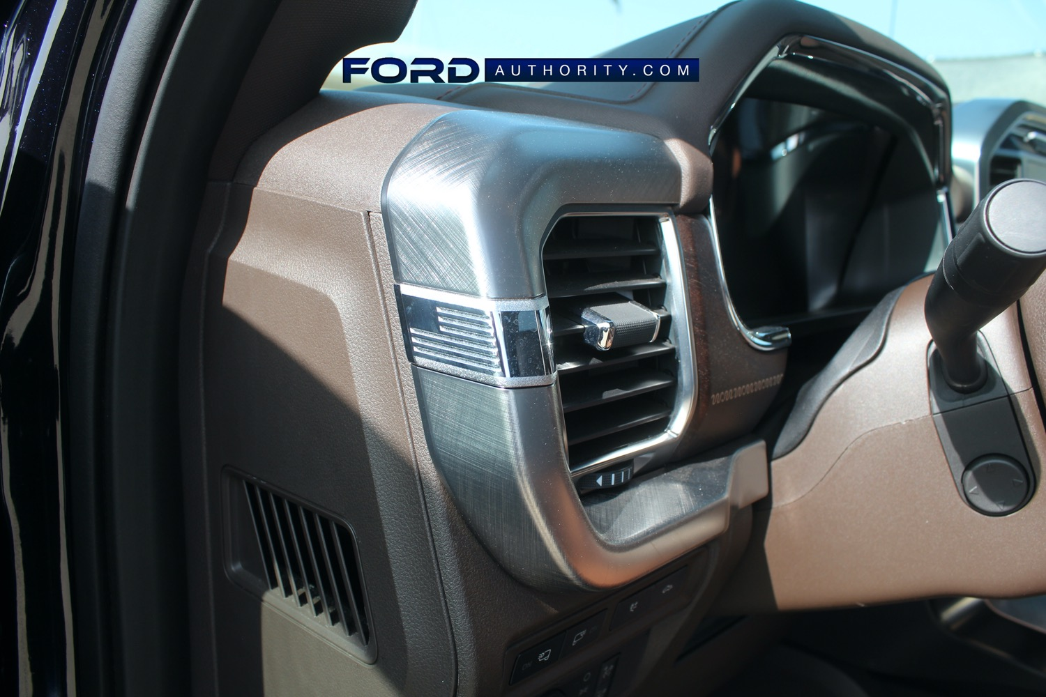 2021-Ford-F-150-King-Ranch-Interior-Front-Row-017-driver-side-AC-vent-US-American-flag-decor.jpg