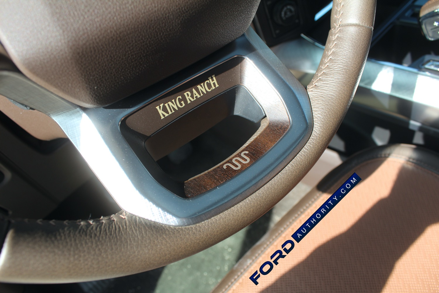 2021-Ford-F-150-King-Ranch-Interior-Front-Row-021-steering-wheel-King-Ranch-logo-and-script.jpg