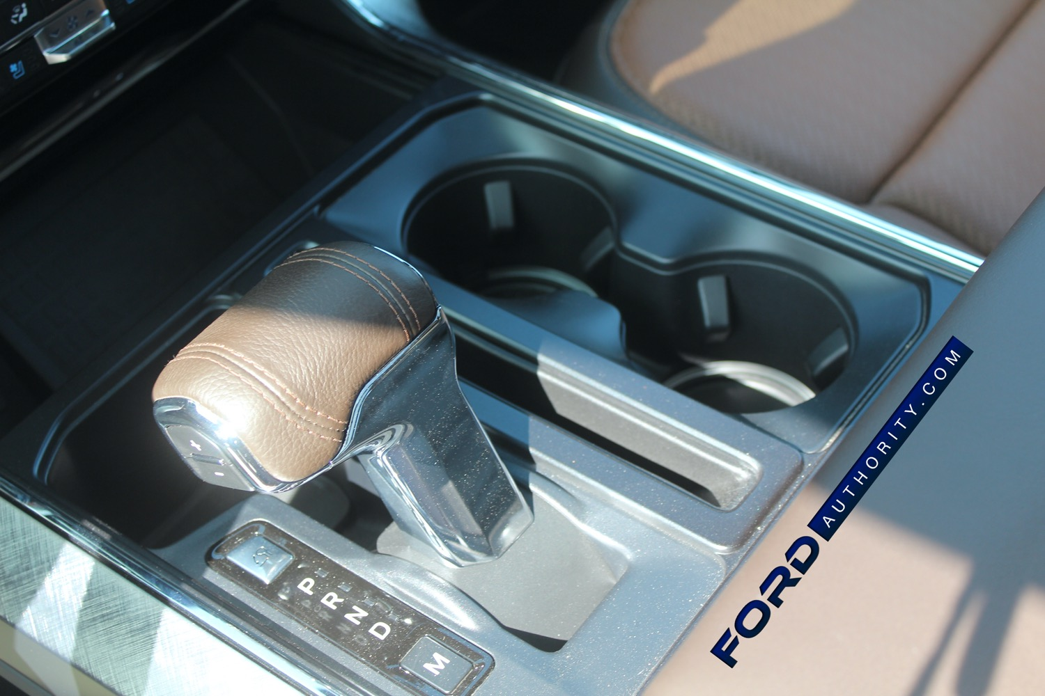 2021-Ford-F-150-King-Ranch-Interior-Front-Row-023-center-console-fold-down-shifter.jpg