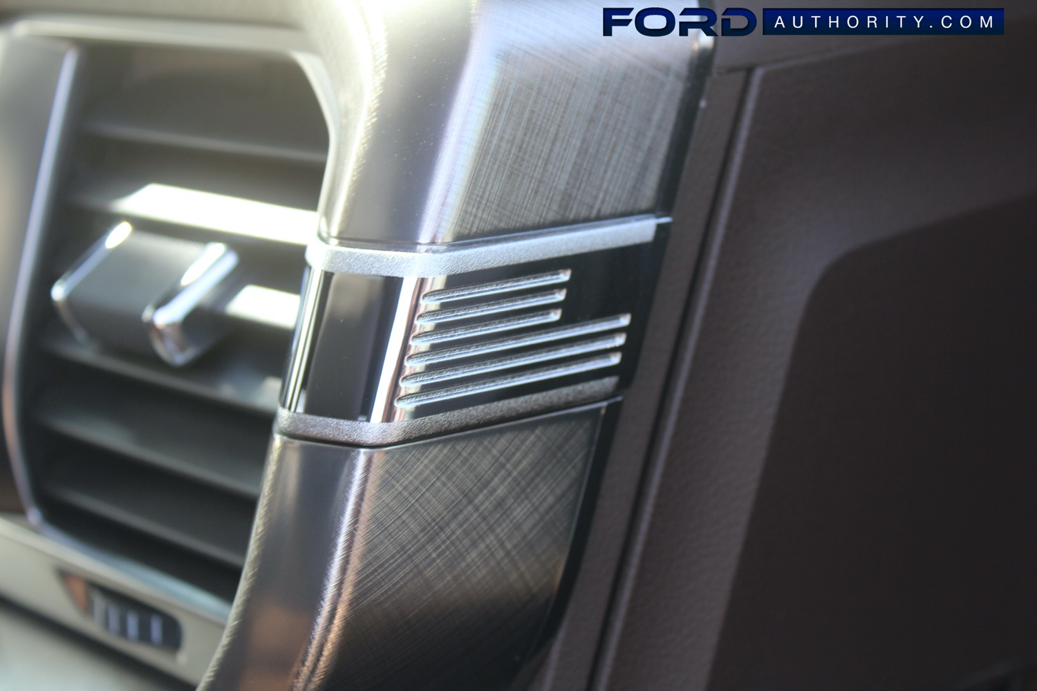 2021-Ford-F-150-King-Ranch-Interior-Front-Row-034-passenger-side-AC-vent-US-American-flag-decor.jpg