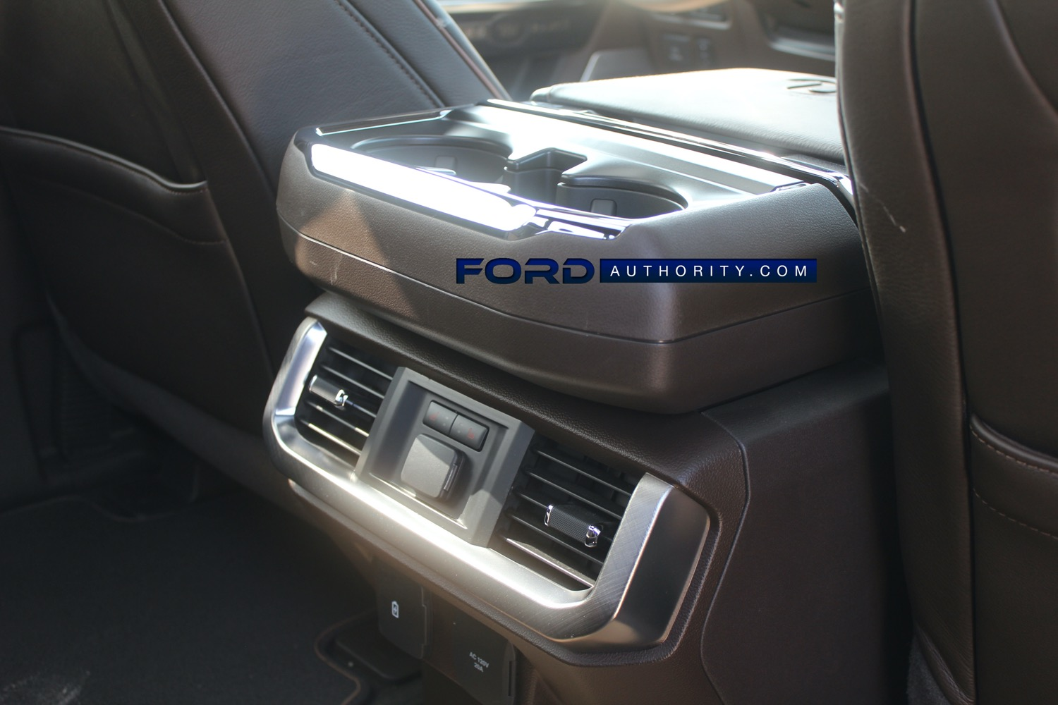 2021-Ford-F-150-King-Ranch-Interior-Second-Row-004-center-console-AC-vents-heated-seat-control...jpg